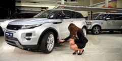 Woman recording a CitNOW sales video of a silver car in the showroom