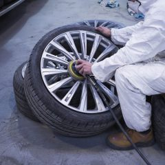 Close up of technician polishing car alloys in the workshop