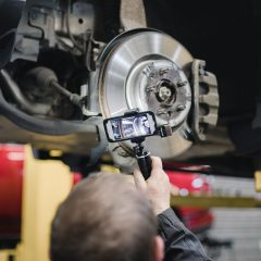 Close up of a man recording a CitNOW workshop video of the cars brake discs
