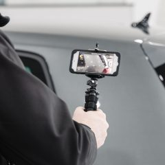 Close up of a man recording a CitNOW sales video of a grey car