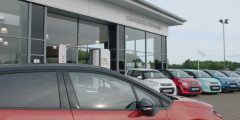 Close up of Town Centre Automobiles dealership entrance with Citroen cars at the front