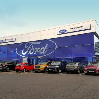 Photo of the Essex Ford store, front of dealership in shot as well as Ford vehicles