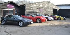 Photo of the front of the Maundrell dealership, sports cars in front of the dealership