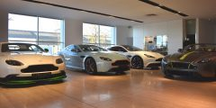 Aston Martin showroom, image features 4 different Aston Martin models