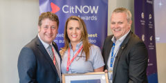 CitNOW CEO, Alistair Horsburgh presenting awards certificate to a man and woman