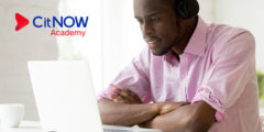 CitNOW Academy banner, man looking at his laptop screen
