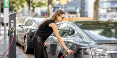 Woman charging her electric car