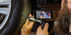 Workshop technician using CitNOW to take tyre tread depth